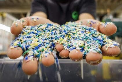 A close up of a student's hands holding plastic pellets
