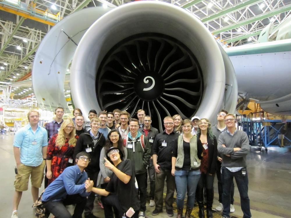 a group of students in a club touring a Boeing facility